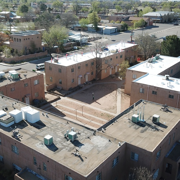 Roofing Project on a small apartment complex showing some complete and others in progress in Albuquerque, NM