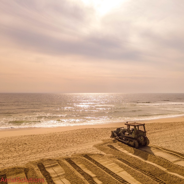 Belmar DPW getting the sand ready for the busy Jersey Shore summer.