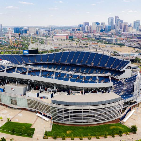 Denver stadium with Denver skyline
