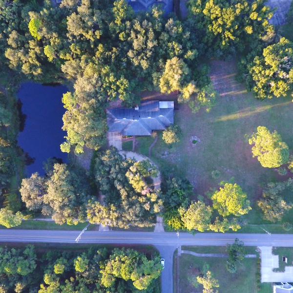 Large lot with pond bird's eye view