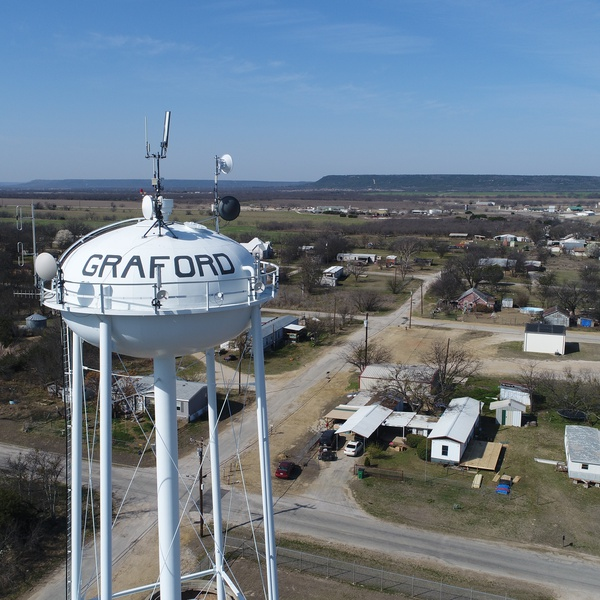 A water tower over looks its city