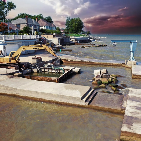 Construction being done to a lake front pool