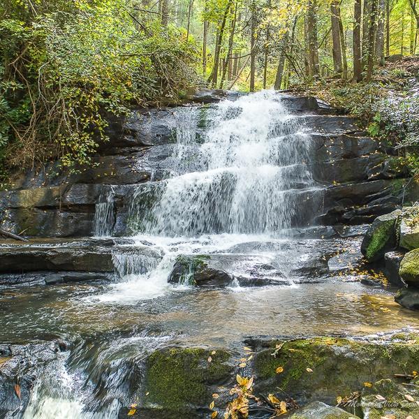 A Waterfall Near a Home